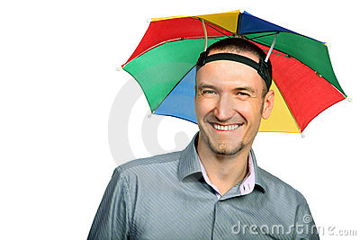 Businessman with rainbow hat umbrella