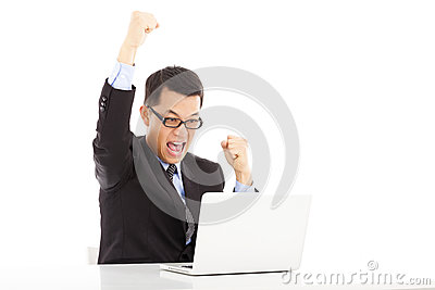 Businessman raise his hands to celebrate victory