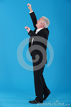 Businessman reaching upwards