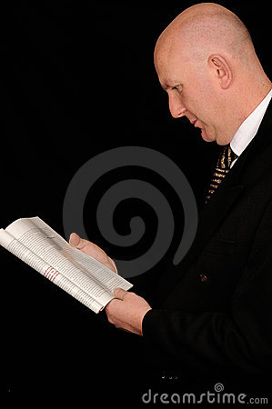 Businessman reading on black