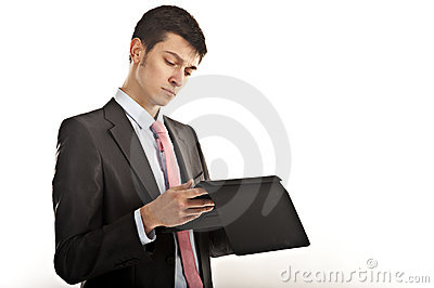 Businessman reading from computer tablet
