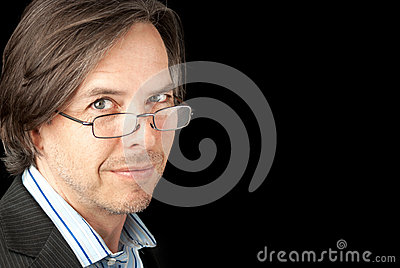 Businessman In Reading Glasses Looks To Camera