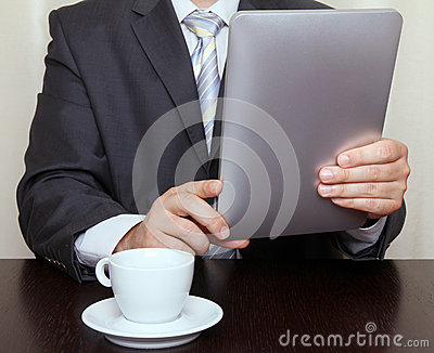 Businessman reading news on tablet