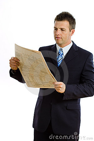 Businessman reading newspaper isolated