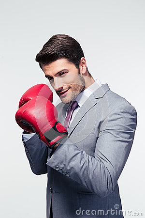 Free Businessman Ready To Fight With Boxing Gloves Stock Photo - 55130250