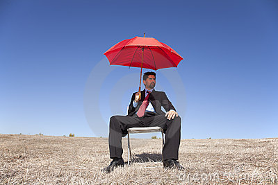 Businessman with a red umbrella