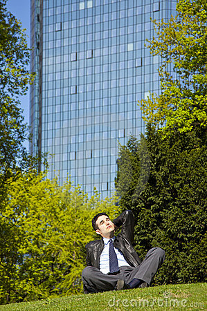 Businessman relaxing in park during lunch break