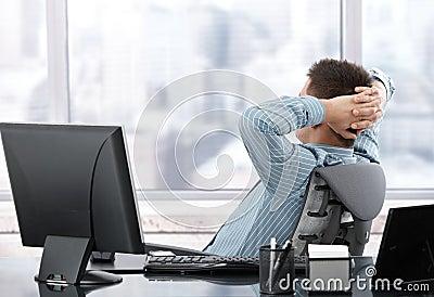 Businessman resting at desk