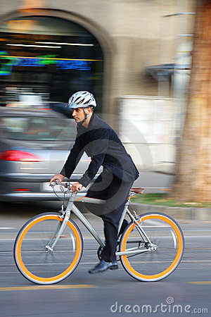 Free Businessman Riding A Bicycle Stock Photography - 19014792