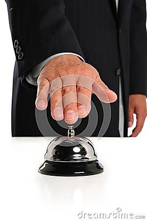 Businessman Ringing Bell