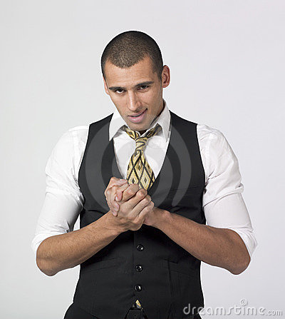 Businessman rubbing hands with a smirk