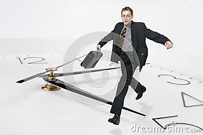 Businessman run through the ti