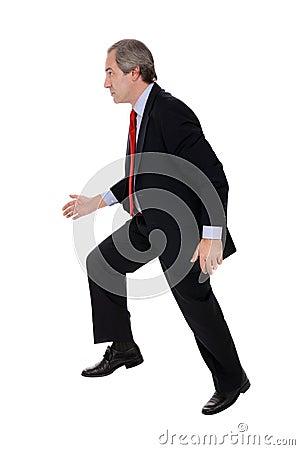 Businessman running away
