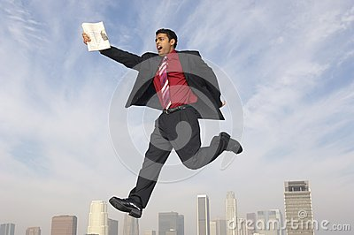 Businessman Running In Midair