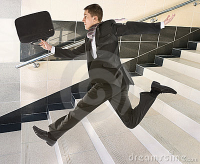 Businessman running on stair