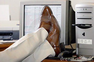 Businessman s Feet Propped Up On The Desk