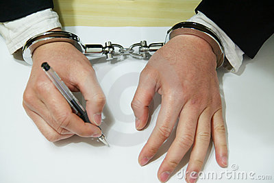 Businessman s Hand In Handcuffs