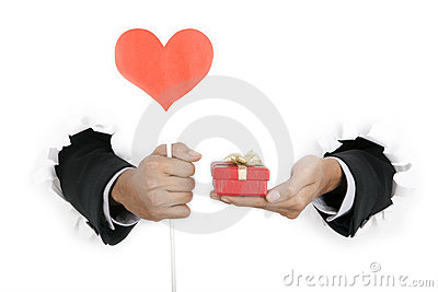 Businessman s hand holding gift and heart cutout