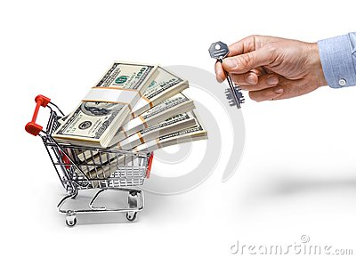 Businessman s hand with a key & steel grocery cart full of money stacks - isolated on white background
