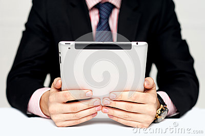 Businessman s hands holding portable device
