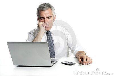 Businessman sad senior thinking laptop computer