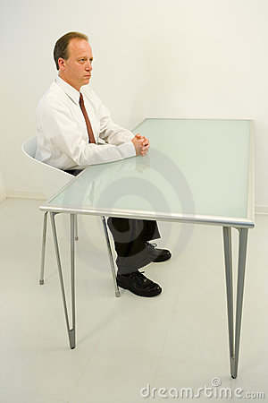 Businessman sat at empty desk
