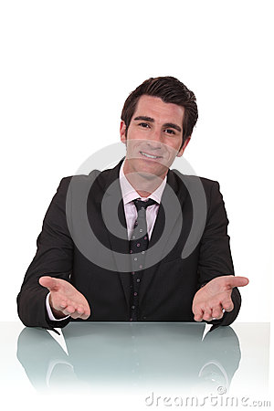 Businessman sat at his desk