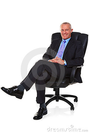 Free Businessman Sat In A Leather Chair. Royalty Free Stock Images - 21968269