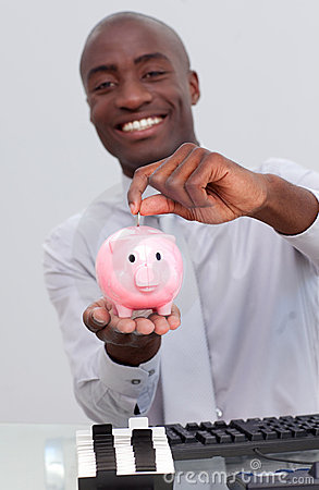 Businessman saving money in a piggybank
