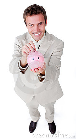 Businessman saving money in a piggybank