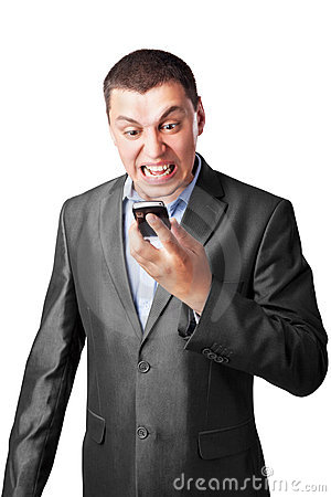 Businessman screaming in cell mobile phone