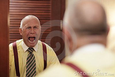 Businessman screaming at himself