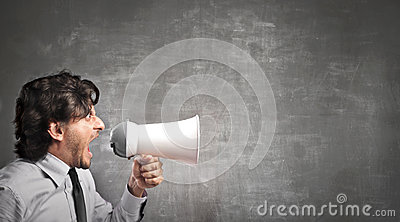 Businessman screaming with a megaphone