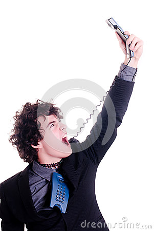Businessman screaming at the phone