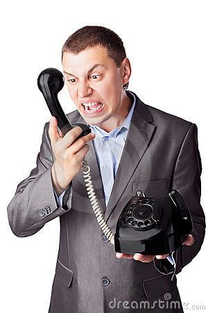 Businessman screaming in telephone receiver