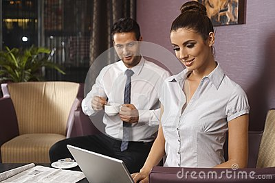 Businessman and secretary at hotel lobby