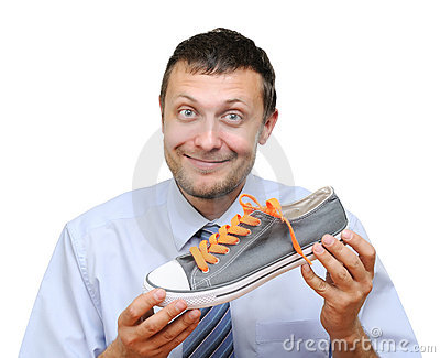 Businessman Seller With Shoe In Hand Royalty Free Stock Photo - Image: 21875725