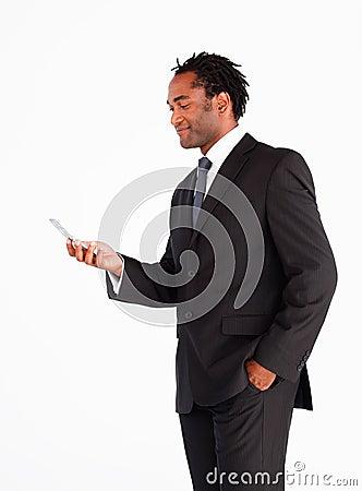 Businessman sending text message