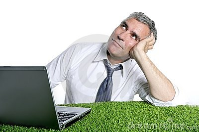 Businessman senior relaxed on green grass desk