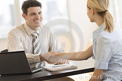 Businessman Shaking Hands With Colleague During Meeting In Offic
