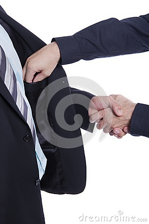 Businessman shaking hands, other hand in pocket