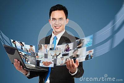 Businessman sharing his photo and video files using laptop
