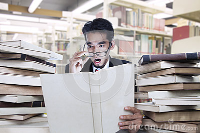 Businessman shock looking at book