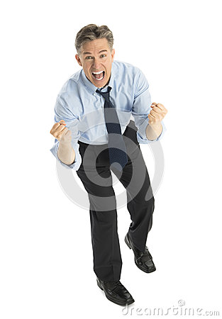 Businessman Shouting While Celebrating Against White Background