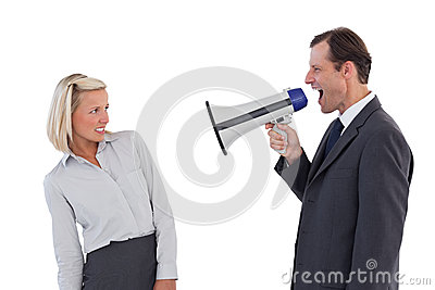 Businessman shouting at colleague with his megaphone