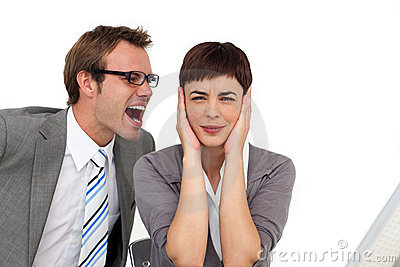 Businessman shouting into his colleague s ear