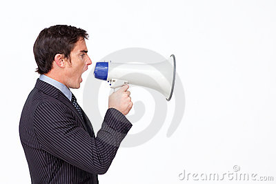 Businessman shouting through a megaphon