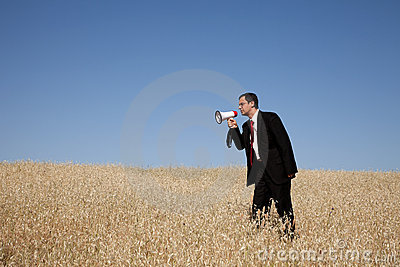 Businessman shouting at the megaphone to you