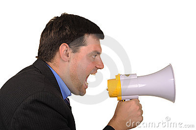 Businessman shouts in  megaphone