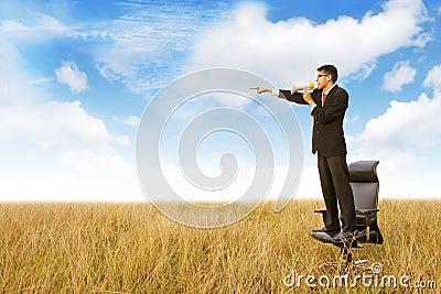 Businessman shouts using megaphone